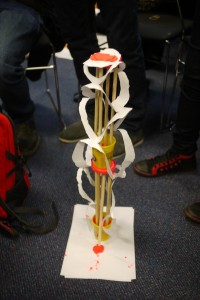 A tower with circular paper adornments.