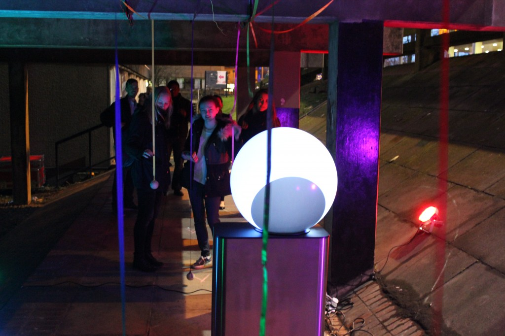 The installation involved a spherical display surrounded by touch sensitive pendulums.  Touching the pendulums made music and flowing graphics from the sphere.