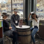 Workshop participants try Oculus Go in a busy restaurant.
